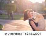 Stock photo girl with baby dog 614812007