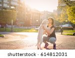 Stock photo girl with puppy 614812031
