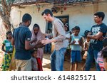 Small photo of India - February 10, 2015: Missionary prays for woman in the village
