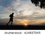 silhouette of a man happy... | Shutterstock . vector #614837045