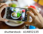 take food with smartphone top... | Shutterstock . vector #614852135