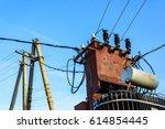 electric transformer on blue... | Shutterstock . vector #614854445
