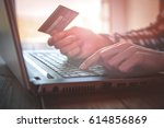 pay by credit card. woman hands ... | Shutterstock . vector #614856869