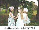 three adorable girls in dresses ... | Shutterstock . vector #614858201