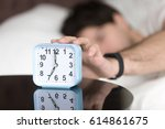 young man sleeping alone is... | Shutterstock . vector #614861675