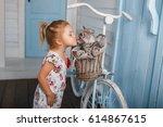 child kiss a cat. little girl... | Shutterstock . vector #614867615
