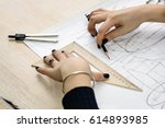 girl architect draws a plan ... | Shutterstock . vector #614893985
