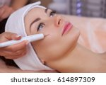 the doctor cosmetologist makes... | Shutterstock . vector #614897309