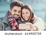 young couple taking a selfie... | Shutterstock . vector #614905739