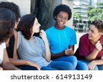 group of talking african... | Shutterstock . vector #614913149