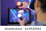 virtual reality game. young man ... | Shutterstock . vector #614920961