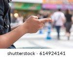 men sit using smartphone on hand | Shutterstock . vector #614924141