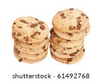 Two stacks of chocolate chip biscuits isolated over a white background. - stock photo