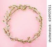 floral frame of spring white...   Shutterstock . vector #614937011