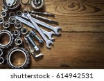 tools and old auto parts on... | Shutterstock . vector #614942531