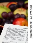 Small photo of Holy Bible open to Galatians 5. Focus on verse 22 - Fruit of the Spirit