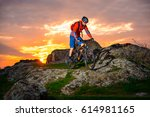 cyclist riding the mountain... | Shutterstock . vector #614981165