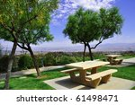 picnic benches in a park setting   Shutterstock . vector #61498471