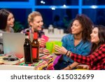 female friends clanging glasses ... | Shutterstock . vector #615032699