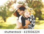 mom hugging and holding her... | Shutterstock . vector #615036224