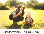 mom and daughter blowing... | Shutterstock . vector #615036239