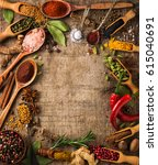 herbs and spices on rough wood | Shutterstock . vector #615040691