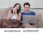 romantic asian couple drinking... | Shutterstock . vector #615043109