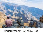 a man is sitting on the edge of ... | Shutterstock . vector #615062255