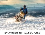 rider on the snowmobile in the... | Shutterstock . vector #615107261