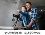 happy excited girl pointing at... | Shutterstock . vector #615109901