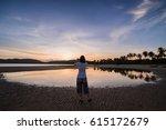 woman traveler taking a sunset... | Shutterstock . vector #615172679