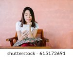 relaxed asian woman use smart... | Shutterstock . vector #615172691
