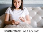 relaxed asian woman use smart... | Shutterstock . vector #615172769