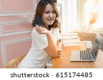 Small photo of Asian woman hand holding credit card with laptop, Technology Online shopping and Security Authorization Access code background concept