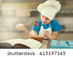 cute little boy preparing a... | Shutterstock . vector #615197165