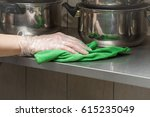 hand in protective glove with... | Shutterstock . vector #615235049