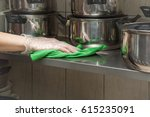 hand in protective glove with...   Shutterstock . vector #615235091