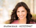 beautiful mature woman smiling.   Shutterstock . vector #615255467
