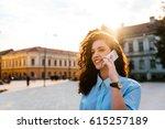 portrait of a woman talking on... | Shutterstock . vector #615257189
