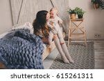 happy mother and baby playing... | Shutterstock . vector #615261311