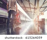 traveler with backpack in train ... | Shutterstock . vector #615264059