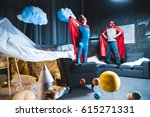 father and son in red superhero ... | Shutterstock . vector #615271331