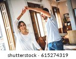 smiling young couple wearing... | Shutterstock . vector #615274319