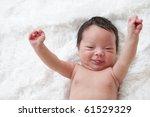 Happy Newborn Baby With Arms U...