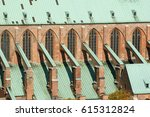 Small photo of Southern side of Lubeck's ancient St. Mary's Church, red brick gothic, arched windows, flying buttress, verdigris covered roofs; World Cultural Heritage Site Hanseatic City of Lubeck, 14/10/2013