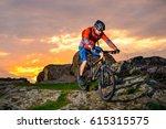 cyclist riding the mountain... | Shutterstock . vector #615315575