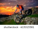 cyclist riding the mountain... | Shutterstock . vector #615315581