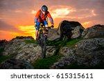 cyclist riding the mountain... | Shutterstock . vector #615315611
