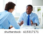 two middle aged employees... | Shutterstock . vector #615317171