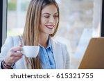 beautiful young woman drinking... | Shutterstock . vector #615321755